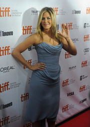Jennifer Aniston donned a lovely draped strapless dress for the TIFF premiere of 'Life of Crime.'  Aniston paired the sky blue dress with classic nude shoes.