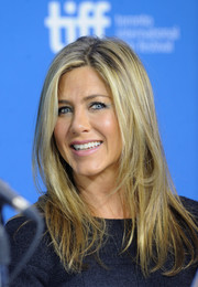 Jennifer Aniston wore her hair down in a layered cut with an off-center part during the TIFF press conference for 'Life of Crime.'
