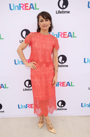 Constance Zimmer looked girly in a coral lace blouse while attending the 'UnREAL' group date and champagne brunch.