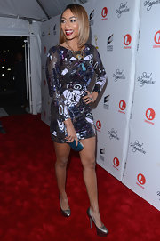 Keri Hilson styled her sparkly shift with these shiny metallic platform pumps.