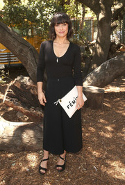 Black diagonal-strap peep-toes sealed off Constance Zimmer's outfit.