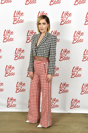 Rose Byrne looked funky in a black, red, and white houndstooth pantsuit by Area at the 'Like a Boss' photocall.