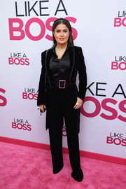 Salma Hayek hit the pink carpet wearing a black velvet pantsuit by Saint Laurent at the world premiere of 'Like a Boss.'