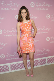 A pink tube clutch by Jimmy Choo sealed off Emmy Rossum's colorful look.