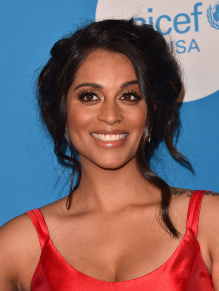 Lilly Singh Messy Updo [hair,hairstyle,eyebrow,shoulder,chin,black hair,long hair,smile,electric blue,neck,arrivals,lilly singh,ball,beverly wilshire four seasons hotel,beverly hills,california,unicef,unicef ball]