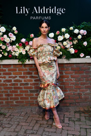 Lily Aldridge looked romantic in an off-the-shoulder floral dress by Brock Collection during the launch of her perfume.