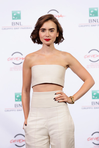 Lily Collins Gold Bracelet Watch [love rosie photocall - the 9th rome film festival,clothing,white,shoulder,waist,crop top,fashion,dress,shirt,fashion model,top,lily collins,rome,italy,auditorium parco della musica,rome film festival]