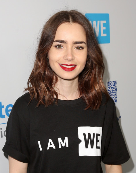 Lily Collins Medium Wavy Cut [hair,face,lip,hairstyle,shoulder,eyebrow,t-shirt,beauty,chin,fashion,come together at we day california,california,selena gomez,demi lovato,alicia keys,lily collins,young people changing the world,miss piggy,bryan cranston,dj khaled]