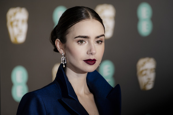 Lily Collins Classic Bun [hair,face,lip,beauty,eyebrow,lady,fashion,skin,hairstyle,chin,red carpet arrivals,lily collins,ee,london,england,royal albert hall,british academy film awards]
