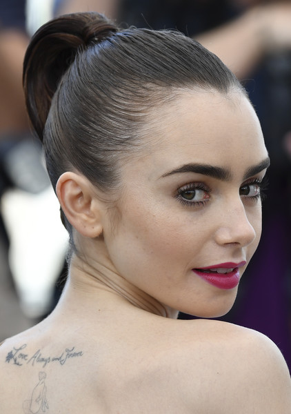 Lily Collins Croydon Facelift [okja photocall - the 70th annual cannes film festival,okja,photo,hair,face,eyebrow,hairstyle,beauty,chin,lip,forehead,skin,chignon,lily collins,british,cannes,france,afp,photocall,edition]