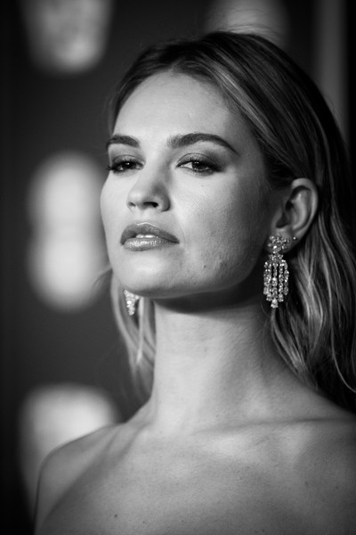 Lily James Diamond Chandelier Earrings [image,face,hair,photograph,black,eyebrow,black-and-white,monochrome,beauty,lip,monochrome photography,red carpet arrivals,lily james,ee,england,london,royal albert hall,british academy film awards]