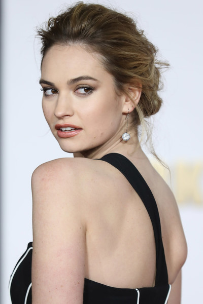 Lily James Diamond Spheres [darkest hour,hair,face,hairstyle,shoulder,beauty,chin,eyebrow,skin,blond,model,red carpet arrivals,lily james,darkest hour,uk,england,london,odeon leicester square,premiere,premeire]