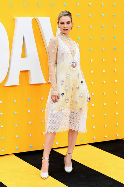 Lily James Beaded Dress [clothing,yellow,fashion model,polka dot,fashion,pattern,design,fashion design,dress,flooring,red carpet arrivals,lily james,uk,england,london,odeon luxe leicester square,premiere]