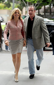 Attorney Lisa Bloom looked lovely in this pink and grey blazer with matching skirt.