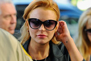 Actress Lindsay Lohan arrives for a mandatory court appearance before a judge at Beverly Hills Courthouse on September 24, 2010 in Beverly Hills, California. Lohan was ordered back to jail for failing a court-ordered drug test. Superior Court Judge Elden S. Fox, who earlier this week revoked the 24-year-old actress' probation, set no bail, pending an October 22 probation hearing, meaning Lohan could spend the next 30 days behind bars.