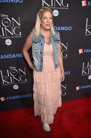 Tori Spelling topped off her dress with a denim vest.