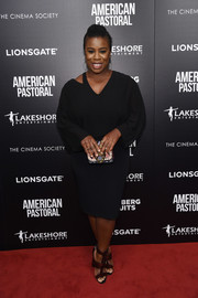 Uzo Aduba accessorized with a multicolored patchwork clutch for a bright spot to her LBD.