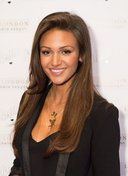 Michelle Keegan wore her long locks down with a side part and a bit of an undercurl for the Lipsy London photocall.
