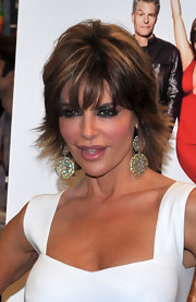 Lisa Rinna wore a gorgeous pair of shimmering earrings at a signing of her book 'Starlit'. She paired the statement jewelry with a simple white dress.