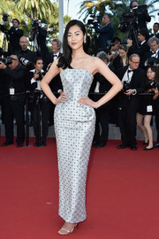 Liu Wen was all about futuristic glamour in an embellished silver strapless gown by Ralph & Russo Couture during the Cannes premiere of 'The Little Prince.'