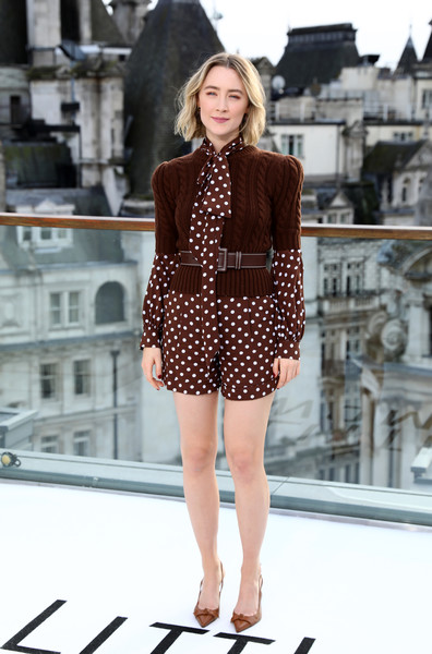 Saoirse Ronan layered a brown cable-knit sweater over a polka-dot blouse, both by Michael Kors, for the 'Little Women' photocall in London.