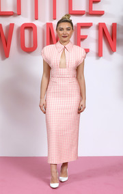 Florence Pugh was equal parts sweet and flirty in a pink gingham cutout dress by Emilia Wickstead at the 'Little Women' evening photocall in London.