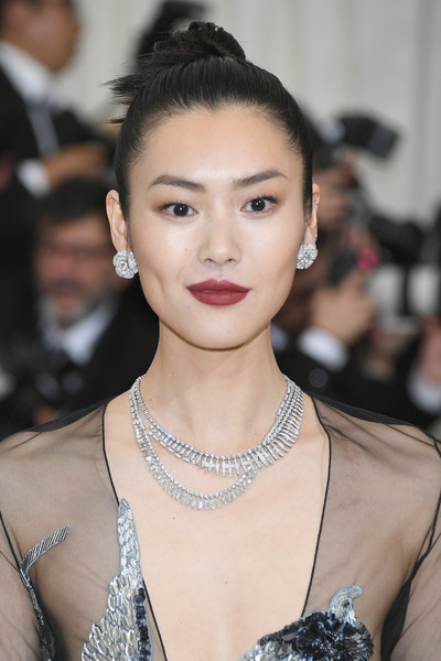 Liu Wen Diamond Studs [rei kawakubo/comme des garcons: art of the in-between,rei kawakubo/comme des garcons: art of the in-between,hair,eyebrow,face,lip,hairstyle,fashion model,skin,beauty,chin,fashion,costume institute gala - arrivals,liu wen,new york city,metropolitan museum of art,costume institute gala]
