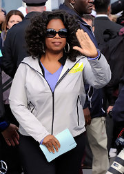 Oprah waved to fans wearing chic black sunglasses.