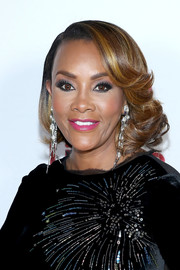 Vivica A. Fox got glam with this curly bob for the 'Vivica's Black Magic' live show and holiday party.