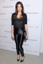 Julia Restoin-Roitfeld oozed seductive appeal in a lace-trimmed black cami and shiny leggings at the 'Living in Style' book launch.