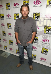 Travis Fimmel chose this pair of faded denim for his look at 'Living the Vikings' panel for History at WonderCon.