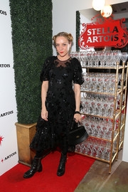 Chloe Sevigny contrasted her ladylike dress with edgy black combat boots by The Frye Company.