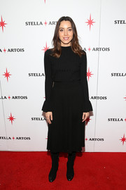 Aubrey Plaza sported a ribbed black sweater with ruffle cuffs at the 'Lizzie' cast party during the Sundance Film Festival.