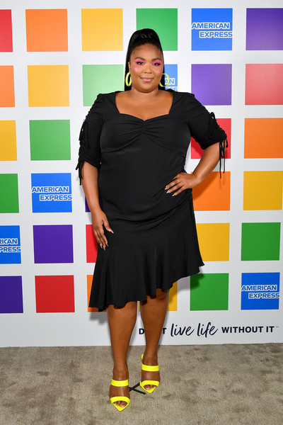 Lizzo Strappy Sandals [clothing,fashion,dress,footwear,little black dress,cocktail dress,event,carpet,fashion design,style,lizzo,proudly backs lgbtq community at american express,new york city,american express,nyc pride kickoff event,lizzo,new york,nyc pride,bet awards 2019,getty images,photograph,stock photography]