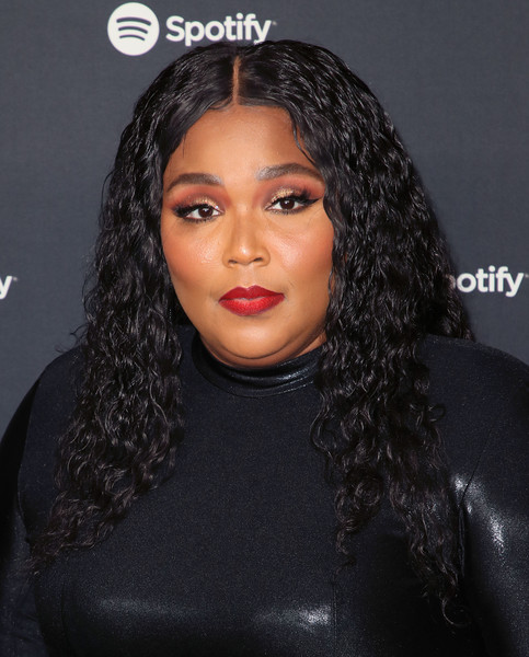 Lizzo Long Curls [hair,face,eyebrow,hairstyle,black hair,lip,forehead,beauty,nose,chin,spotify,party - arrivals,best new artist,lizzo,los angeles,california,the lot studios,best new artist 2020 party,lizzo,grammy award for best new artist,spotify,grammy awards,celebrity,tank and the bangas,streaming media,artist,musician]