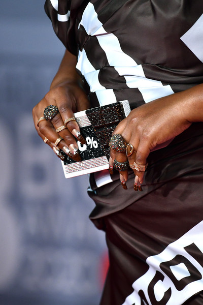 Lizzo Nail Art [hand,eyewear,street fashion,competition event,sunglasses,championship,red carpet arrivals,lizzo,brit awards,detail,nail,bag,england,london,the o2 arena,the brit awards 2020,2020 brit awards,el lloron,nail,red carpet,pop crave on,carpet,fashion,2020,february 18,red]
