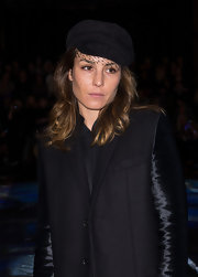 Noomi Rapace attended the Local Firm fashion show wearing a black newsboy cap with mesh detailing.