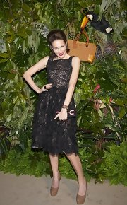 Adriana Abascal teamed her flirty knee length lace dress with tan platform pumps.