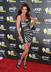 Janice showed that she's still got it, rockin' a sexy figure-hugging mini dress with sparkling platform heels.