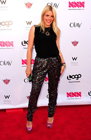 Busy Philipps glammed up her sequined trousers by pairing them with sexy purple peep toe platforms at the 2012 NewNowNext Awards.
