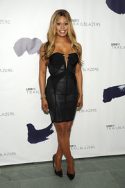 Laverne Cox looked fiercely sexy in a curve-hugging Herve Leger strapless LBD with a deep-V slash during the Logo TV Trailblazers event.