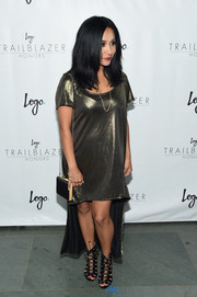 Nicole Polizzi gleamed in a high-low gold T-shirt dress during the Trailblazer Honors.