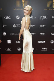 The dramatic dipped back on Julia Dietze's champagne silk evening gown turned up the glamour quota on this red carpet.