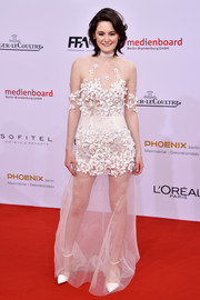 Lea van Acken looked sexy yet adorable in a sheer, flower-appliqued white gown at the German Film Awards.