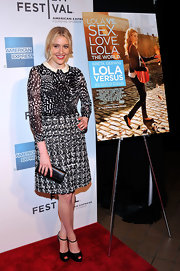 Greta Gerwig sported clashing prints with this skirt and blouse combo at the 'Lola Versus' premiere.