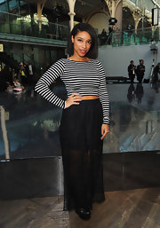Lianne La Havas' long black skirt added a bit of flare to her look with its see-through fabric.