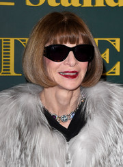 Anna Wintour stuck to her signature bob with blunt bangs when she attended the London Evening Standard Theatre Awards.