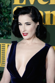 Dita Von Teese attended the London Evening Standard Theatre Awards wearing her signature victory rolls.
