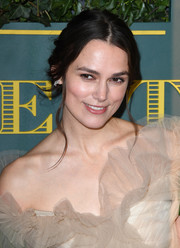Keira Knightley styled her hair into a loose center-parted bun for the London Evening Standard Theatre Awards.