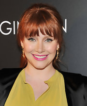 Bryce Dallas Howard complemented her chartreuse gown with a shocking pink lipstick at a screening of 'When You Find Me.'